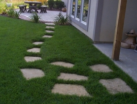 Flagstone in turf